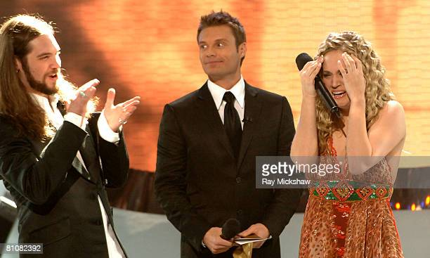 American Idol Season 4 Top 2 Finalists Bo Bice from Helena Alabama and Carrie Underwood from Checotah Oklahoma with Ryan Seacrest host