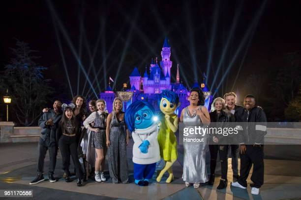 'American Idol' Top 10 Contestants pose with Joy and Sadness from the Pixar film 'Inside Out' following a performance in front of Sleeping Beauty...