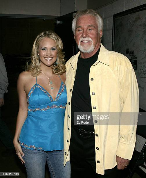 American Idol winner Carrie Underwood meets with country legend Kenny Rogers backstage at the CMT's 100 GREATEST DUETS concert A celebration of the...