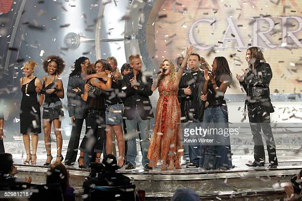 American Idol winner Carrie Underwood performs with the finalists onstage at the American Idol Finale Results Show held at the Kodak Theatre on May...