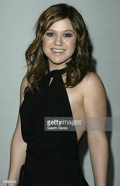 American Idol winner in 2002 Kelly Clarkson poses at a performance at The Avenue at St James's June 4 2003 in London England