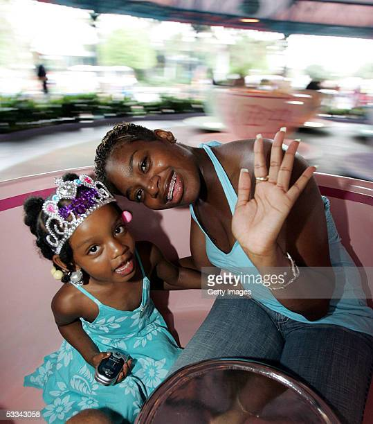 American Idol winner in 2004 Fantasia Barrino celebrates her daughter Zion's fourth birthday while taking a spin in a Mad Tea Party teacup in...