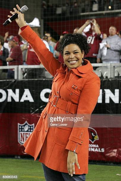 American Idol winner Jordin Sparks sing the National Anthem before a game between the Arizona Cardinals and the San Francisco 49ers at University of...