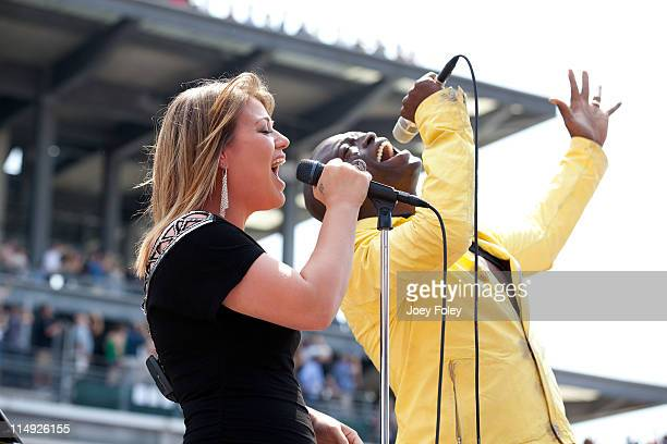 American Idol winner Kelly Clarkson and Grammy Award winner Seal perform the national anthem as a duet during the 100th Anniversary Indianapolis 500...
