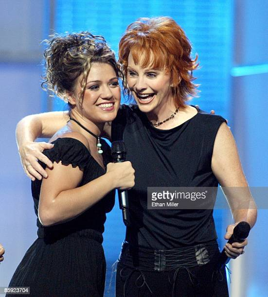 American Idol winner Kelly Clarkson and singer Reba McEntire embrace at the end of the American Idol in Vegas concert at the MGM Grand Garden Arena...