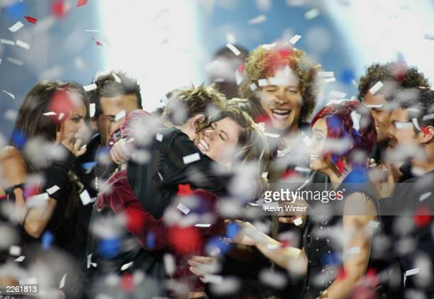 American Idol winner Kelly Clarkson embraces Idol contestants at the Kodak Theatre in Hollywood Ca Sept 4 2002