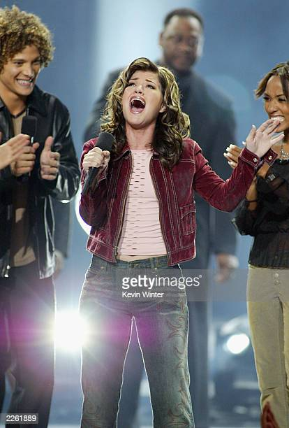 American Idol winner Kelly Clarkson sings after winner the contest at the Kodak Theatre in Hollywood Ca Sept 4 2002