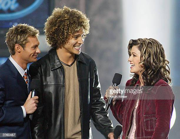 American Idol winner Kelly Clarkson with host Ryan Seacrest and Justin Guarini right after Clarkson was announced the winner of the contest at the...