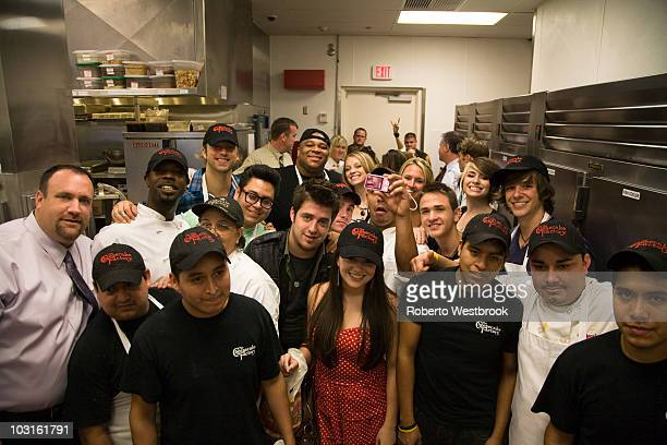 American Idols celebrate National Cheesecake Day with Cheesecake Factory staff in the kitchen of The Cheesecake Factory on July 29 2010 in Virginia...