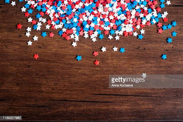 american independence day background with blue, white and red mixed stars. celebration of american independence day, the 4th of july (the fourth of july). holiday concept. top view. with copy space. - fourth of july background stock pictures, royalty-free photos & images