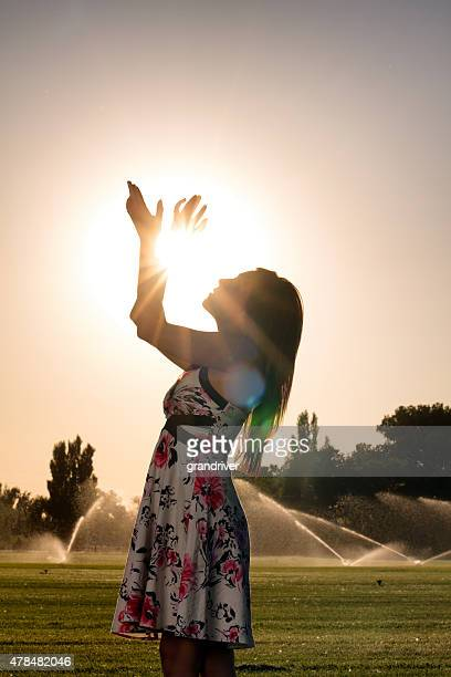 American Indian Girl Holding the Sun