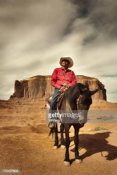 American Indian Navajo Cowboy Riding Horse in Southwest USA Vertical
