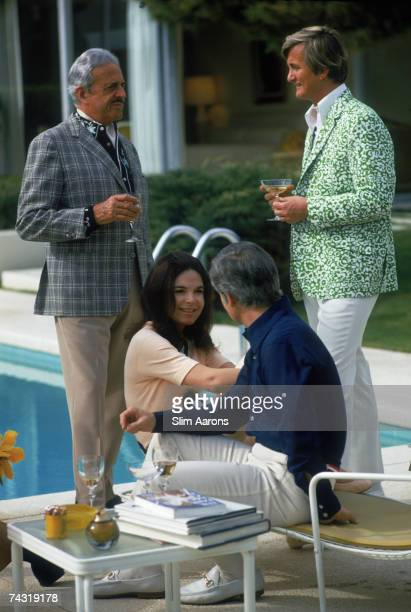 American industrial designer Raymond Loewy and his wife Viola Erickson at a poolside party at the Desert House Inn Palm Springs California 1970