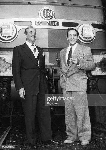 American industrial designer Raymond Loewy in Paris with French engineer Paul Arzens designer of the CC 7110 railway locomotive used by the French...