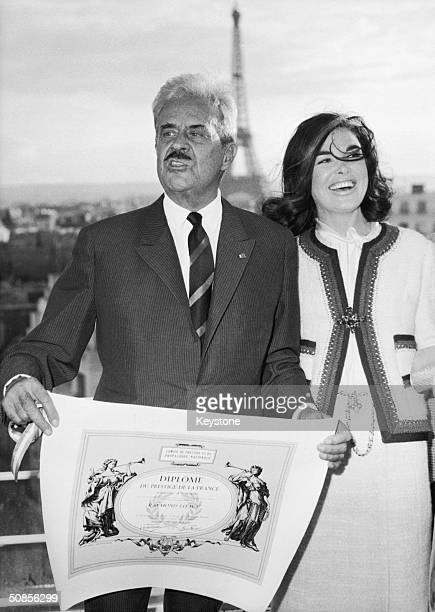 American industrial designer Raymond Loewy receives a Prestige de la France diploma at a ceremony in Paris 18th September 1964 He is accompanied by...