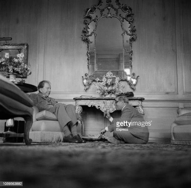 American industrialist and founder of Getty Oil Jean Paul Getty pictured seated on left with Greek shipping tycoon Aristotle Onassis at Sutton Place...