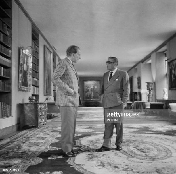 American industrialist and founder of Getty Oil Jean Paul Getty pictured on left with Greek shipping tycoon Aristotle Onassis in the library at...