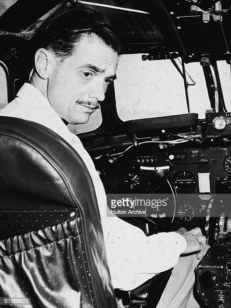 American industrialist aviator and film producer Howard Hughes sits in the cockpit of a plane during a demonstration of the plane's radar 1947
