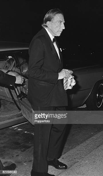American industrialist billionaire J Paul Getty arrives at London Zoo for a fancy dress party carrying a lion mask 13th July 1972 The party is hosted...