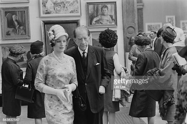 American industrialist J Paul Getty and his secretary attend a private viewing at the Royal Academy of Arts London 28th April 1967