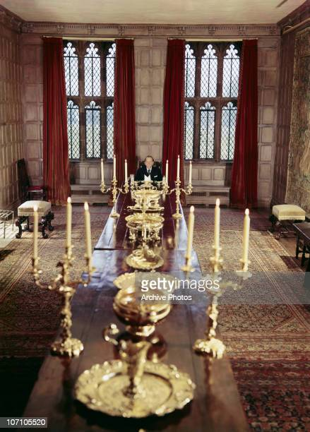American industrialist J Paul Getty in the dining room of Sutton Place his Tudor manor house in Surrey circa 1960