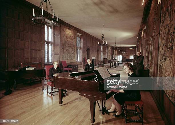 American industrialist J Paul Getty listens to a piano recital in Sutton Place his Tudor manor house in Surrey circa 1960