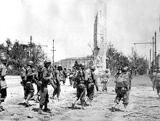 American infantrymen enters battlescarred Messina shortly after its fall