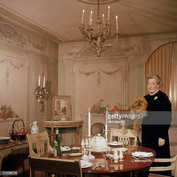 American interior decorator Sister Parish cofounder of ParishHadley Associates prepares dinner for four in New York 1960