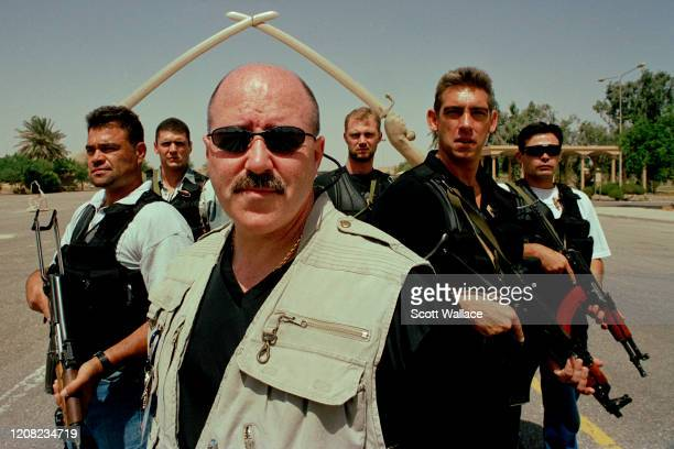 American Interior Minister of the Iraqi Coalition Provisional Authority and former law enforcement official Bernard Kerik poses with his security...