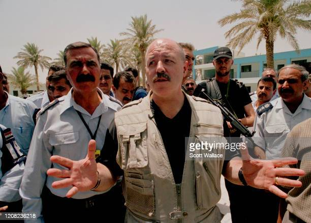 American Interior Minister of the Iraqi Coalition Provisional Authority and former law enforcement official Bernard Kerik conducts an on-site visit...