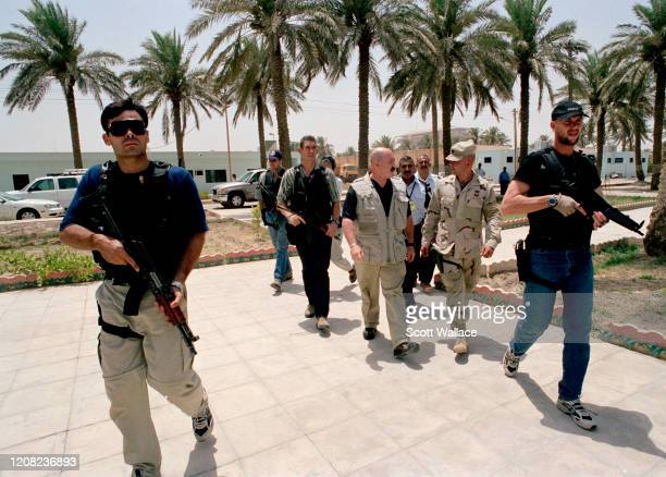 American Interior Minister of the Iraqi Coalition Provisional Authority and former law enforcement official Bernard Kerik arrives, with his security...