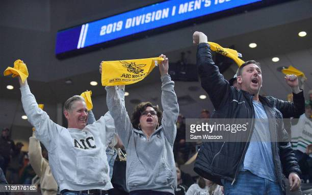 American International Yellow Jackets fans cheer after Joel Kocur scored a goal in the first period against the St Cloud State Huskies during an NCAA...
