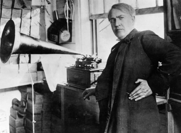 Thomas Alva Edison with the his invention, the phonograph....