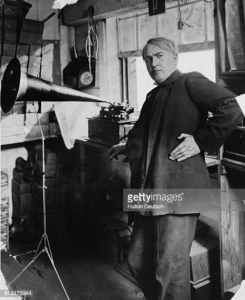 The American inventor Thomas Edison with his phonograph which he patented in 1878 and some of his other inventions