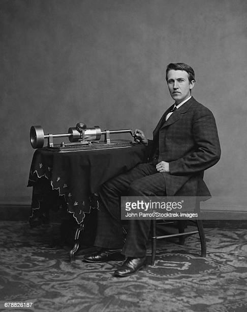 American inventor and businessman, Thomas Edison with his second phonograph, circa 1878.