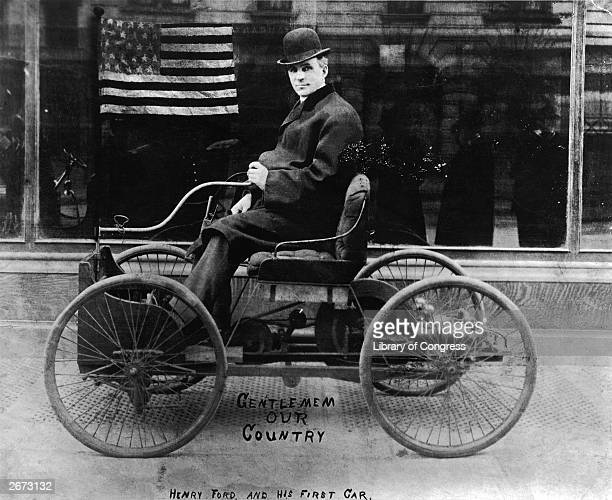 American automobile engineer and manufacturer Henry Ford in his first car built in 1896 The photograph has been painted with the Stars and Stripes...