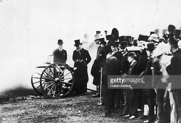 American inventor Hiram Maxim demonstrates his early machine gun the Maxim Gun to the Prince of Wales later King Edward VII 1888 The prince is...