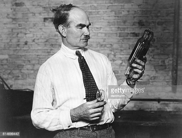 American inventor Lee De Forest is shown with his Audion vacuum tube which enabled live radio broadcasts