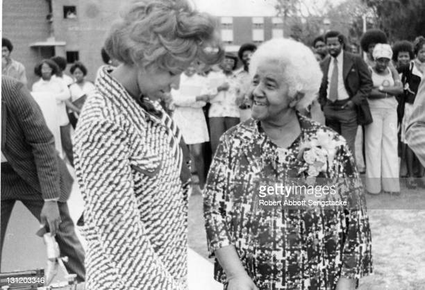 American inventor Marjorie Stewart Joyner speaks with an unidentified woman at an unidentified outdoor event late 1960s Joyner was one of the first...