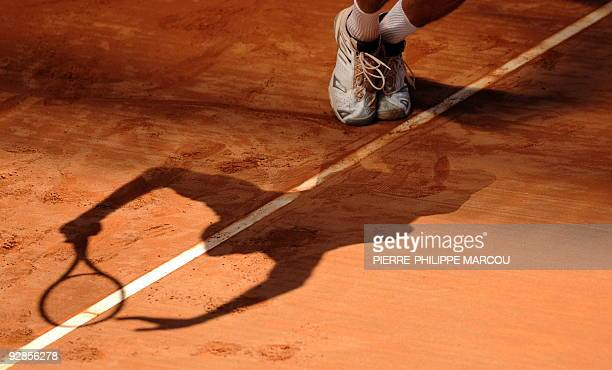 American James Blake serves to Ivo Karlovic of Croatia during their match of the ATP Madrid Masters claycourt tournament on May 13 2009 Blake won 67...