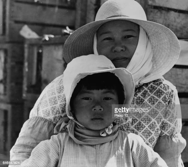 American Japanese mother and daughter, agricultural workers near Guadalupe, California by Dorothea Lange 1895-1965, dated 1937.