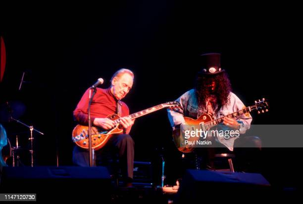 American Jazz and Blues musician Les Paul and BritishAmerican Rock musician Slash play guitars together at the House of Blues Chicago Illinois...