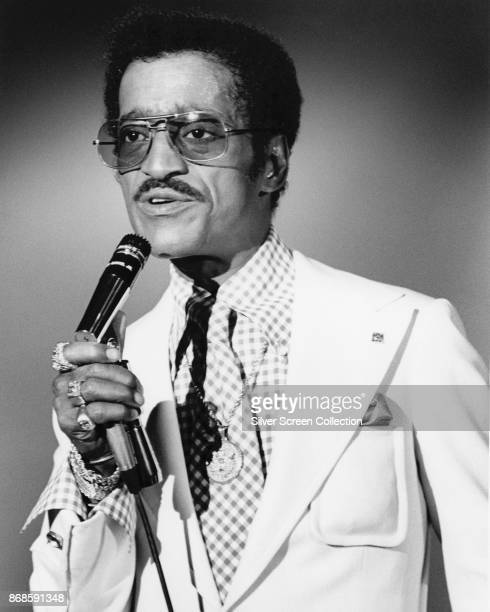 American Jazz and Pop musician Sammy Davis Jr sings into a microphone on an unspecified television show late 1960s or early 1970s
