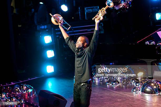 American jazz and R&B musician Trombone Shorty onstage during a performance at the Red Hot + New Orleans concert, in recognition of World AIDS Day,...