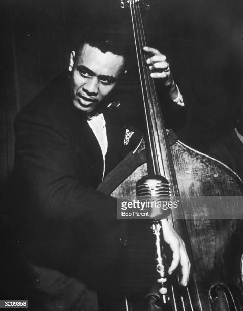 American jazz bandleader Charles Mingus playing bass