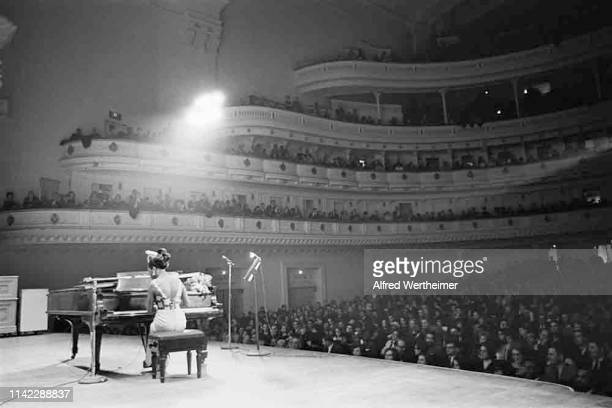 American Jazz & Blues musician and Civil Rights activist Nina Simone plays piano as she performs onstage at Carnegie Hall, New York, New York, April...