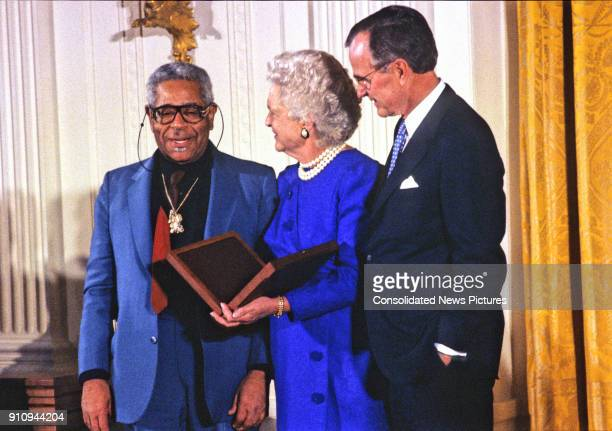 American Jazz composer and musician Dizzy Gillespie is awarded the National Medal of Arts by US First Lady Barbara Bush and President George HW Bush...
