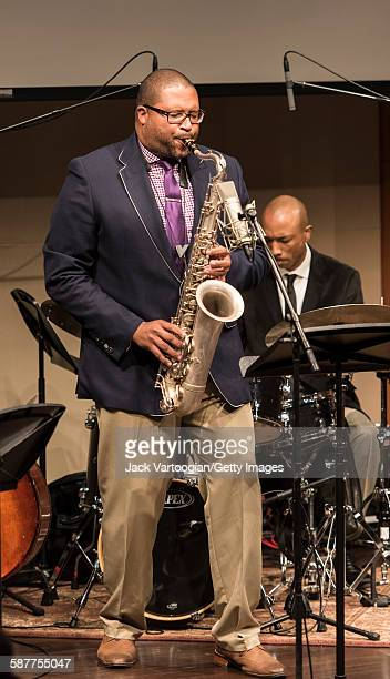 American Jazz composer and musician Jimmy Greene plays tenor saxophone as he performs with his quintet during an 'MSM Student Project in Performance...