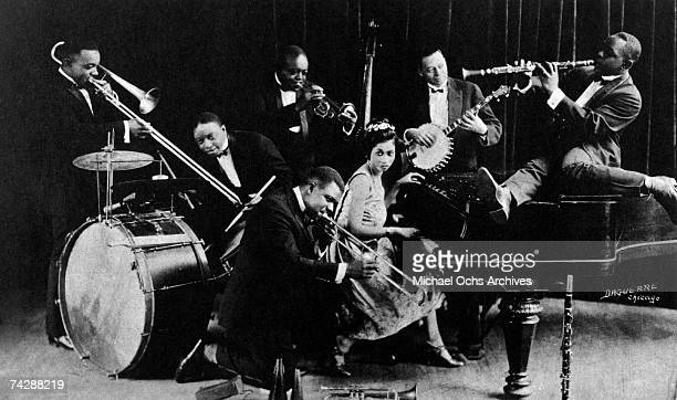 American jazz cornet player and bandleader King Oliver with Honoré Dutrey, Baby Dodds, Louis Armstrong, Lil Hardin Armstrong, Bill Johnson, Johnny...
