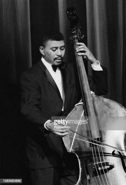 American jazz double bassist Paul Chambers performs live on stage with the Miles Davis Quintet at the Gaumont Palace venue in Hammersmith, London in...
